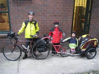 Charles Scott and his children with their bikes.