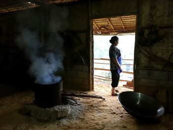 Hmong women cooking in one of their houses.