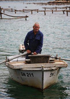 Luko Maskaric checks his oyster crop.