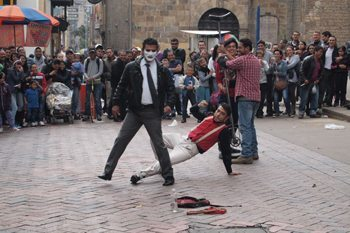 Street clowns are a part of Bogota's charm, these comics were performing outside of the Gold Museum. Photo by Max  Hartshorne.