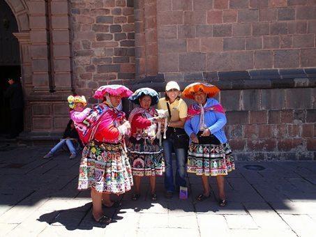 Local Inca women at Coricancha Cusco. Sacred Valley Peru