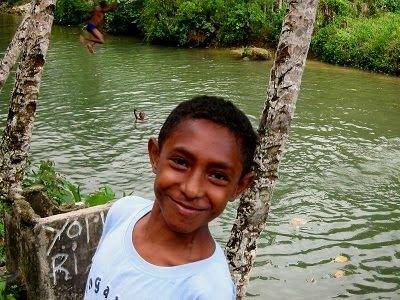 Friendly local at a swimming hole in Fak-Fak, West Papua. photos by Michael Britton.