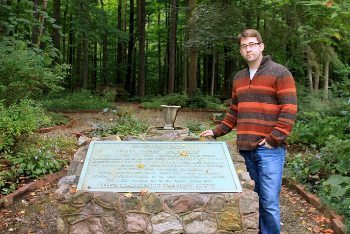J.W. Ocker in front of a memorial to the Fox sisters in NY.