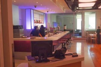 Club lounge with a very long bar, gets hopping each night at Yotel.
