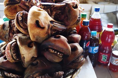 Cow heads in a Cusco market.