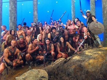 Male and female actors pose on the set of Spartacus.