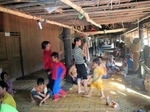 Kids playing in a longhouse in Borneo. S. Bedford photo.