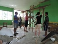 Volunteers rebuilding a school in the Philippines