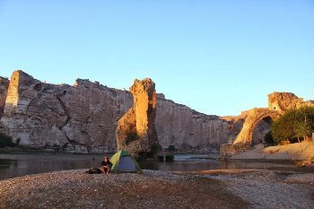 Waking up on the banks of the Tigris River, beneath the 11,000 year old inhabitations at Hasankeyf.