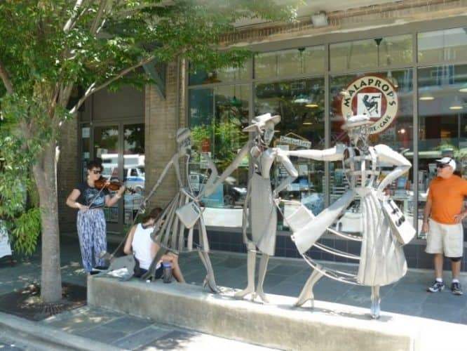 Street performers and sculptures in downtown Asheville, North Carolina