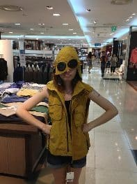 Trying on a unique piece of designer clothing at a large mall in Daegu