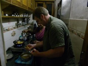 Tourists cooking with Indian family