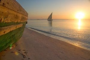 A fishing dhow returns to shore as the sun rises, Vilanculos. photos by Pip Strickland.