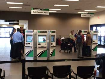Self-service kiosks in a Los Angeles Enterprise location.