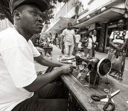 A streetside tailor in Maputo.