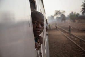 Riding a train in Mozambique.
