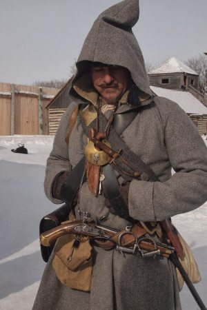 A costumed voyageur, French fur trappers who settled Winnipeg.