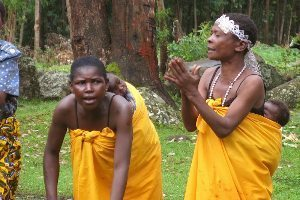 Batwa moms performing.