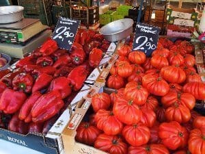 Tomatoes and peppers in the market in Nice.