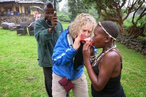 Margie Goldsmith teaching pygmies to play the harmonica in Uganda.