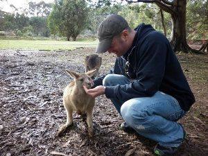 Lee Abbamonte feeding wallabees in tasmania