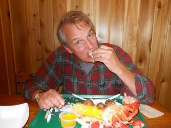 Mike Urban chows down on lobster, one of his favorite foods.