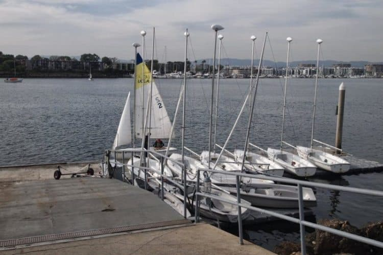 Sailboats await at the UCLA Sailing Center in Marina del Rey, California.