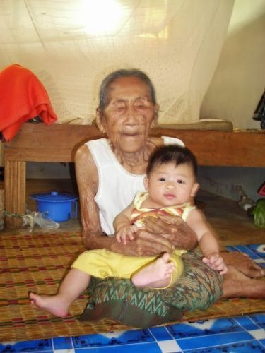 Old Woman and Baby in Thailand.