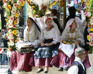 Girls in Caligiari, at the parade of a feast. photos by Max Hartshorne.