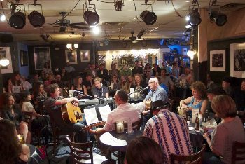 At the Bluebird Cafe, the performers sing in the middle of the room. Just like on the TV show.
