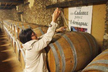 Laurent Deche, at Chateau de Millet in Eauze, France taps a sample of aging Armagnac. Max Hartshorne photos.