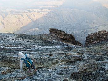 Climbing down.