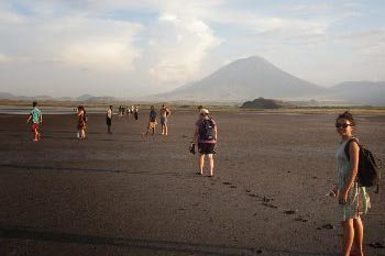 Lake Natron in Tanzania.volcano had been all black and brown but now we saw that it was stained with surreal yellow and white patches of soft porous rock.