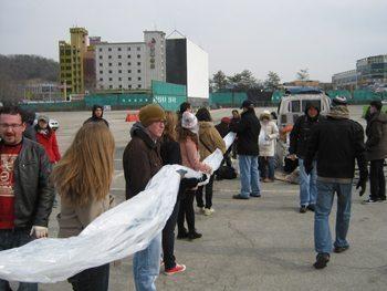 Volunteers in Korea prepare to send socks by balloon over the border to North Korea.