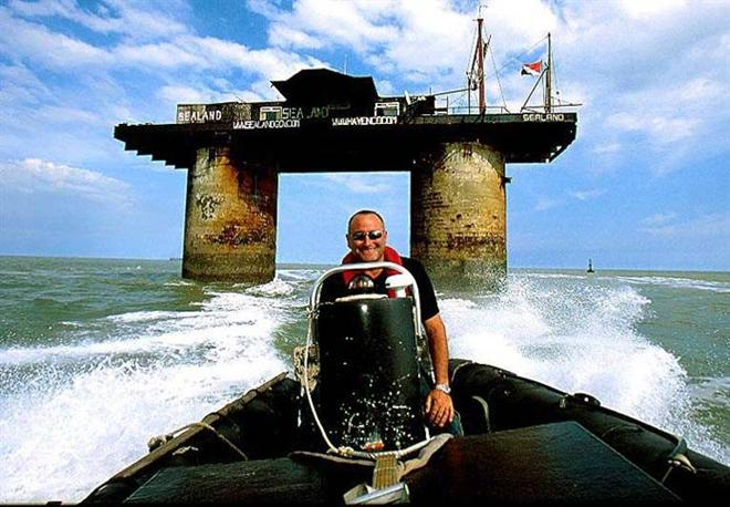 Prince Michael rides his boat with Sealand in the background. Photos from www.sealandgov.org