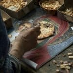 A mosaic artist captures, in thousands of tiny pieces of colorful stone, a Madonna with child at the Barsanti Art Center in Pietrasanta. Photos by John Keahey