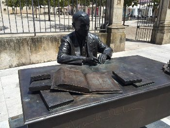 A bronze statue of a famous local author in Viseu. Max Hartshorne photo.