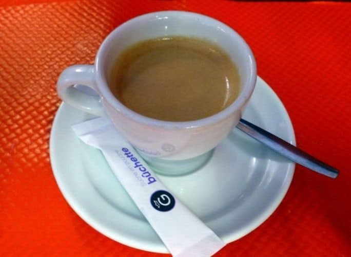 Cup of Espresso, always after the meal, not during.