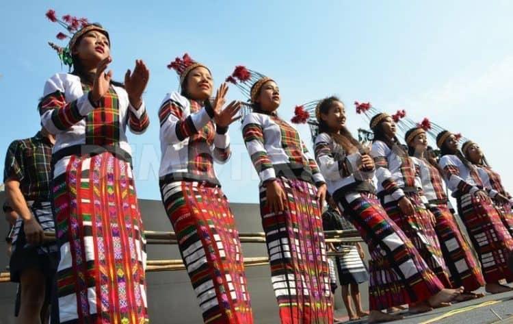 Members of the Adi Tribe dancing in India.