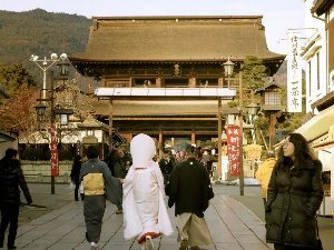 Nagano, Japan: A rare glimpse of a bride in a traditional gown, on her way to Zenkoji Temple.