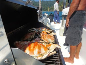 Grilling crabs for lunch, a lucky trade with local fisherman for a few cans of cold drinks.