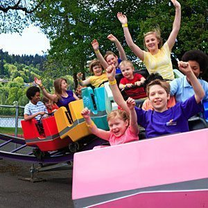 Ride a roller coaster at Oak's Amusement Park