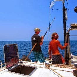 Skipper Mike and a fellow Intrepid Traveller reel in a fish that Marie whips into a delicious lime-ginger ceviche.