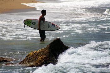 A surfer in Rincon, Puerto Rico: This island is very gay friendly.