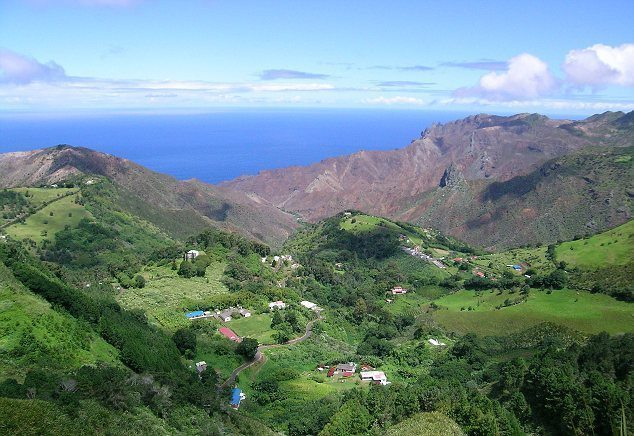 The rolling green vegetation covers the large volcanic mountains