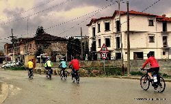 Biking through Korce in the rain.