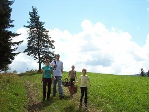 The family off to hunt mushrooms in beautiful Wallachia, Czech Republic.