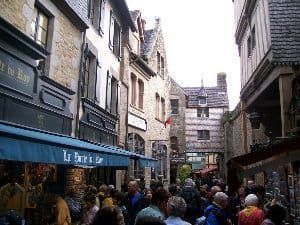 Inside Mont St Michel, a maze of shops and stone pathways leading to the top.