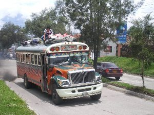 A local bus with a passenger up top.