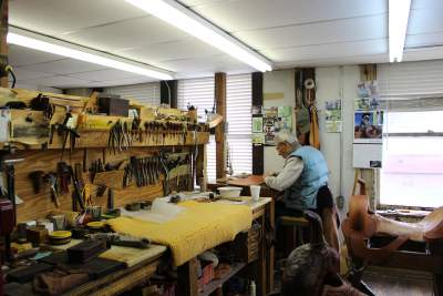 A man working on a saddle at M.L. Leddy's. Stephanie DiCarlo photos.